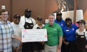 Dunkin' Donuts Provides $5K to Local Backpack Program