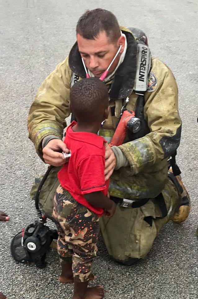 SLC firefighter comforts little boy as his house burns