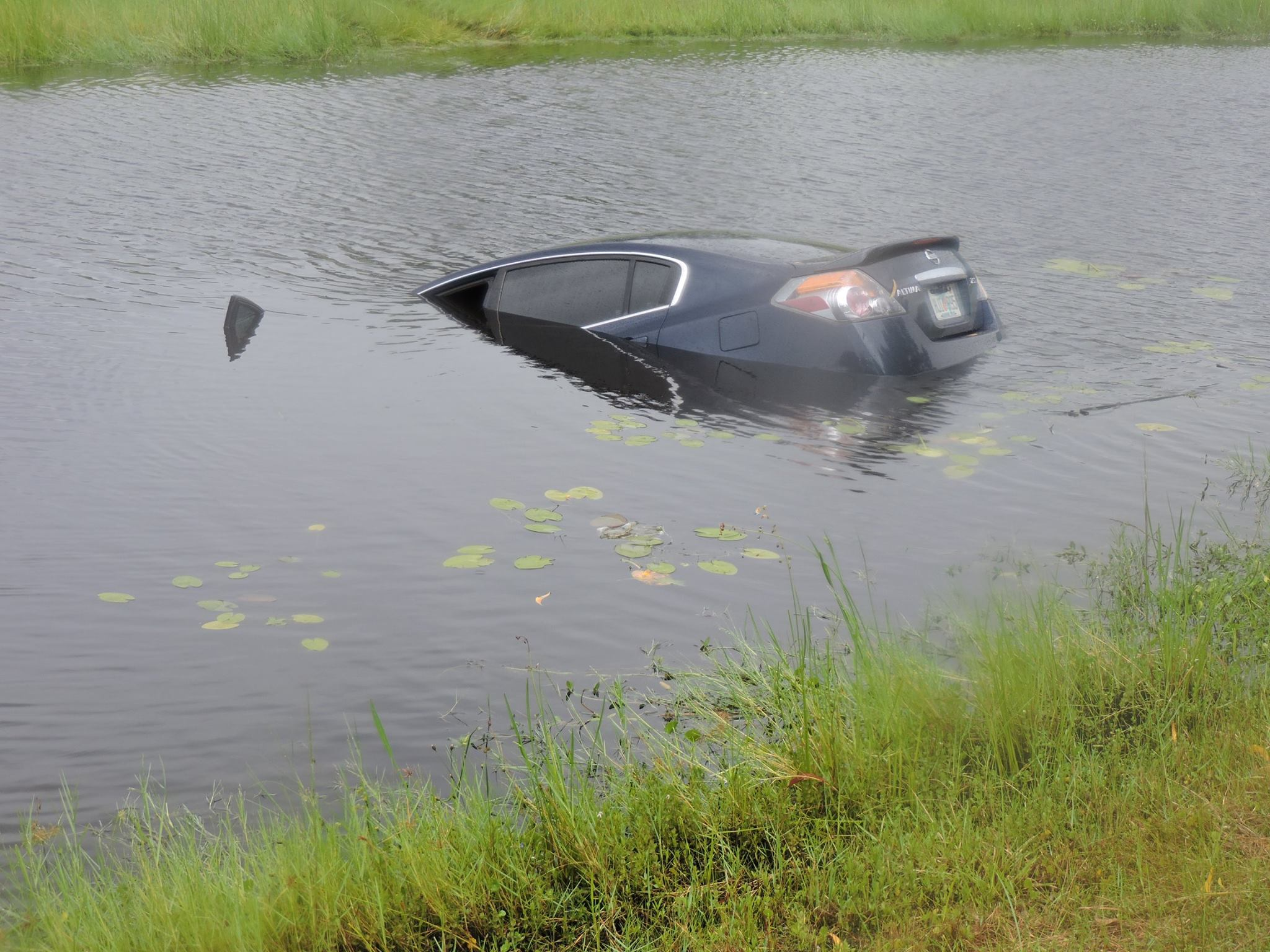 PSL: Vehicle driven off road into canal